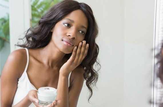 Black woman treating hormonal acne